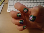 current nails!  forest green base.   white flowers, one on each nail.  purple and/or pink polish on top of the white.  every flower has a light green stem.  adorables!
