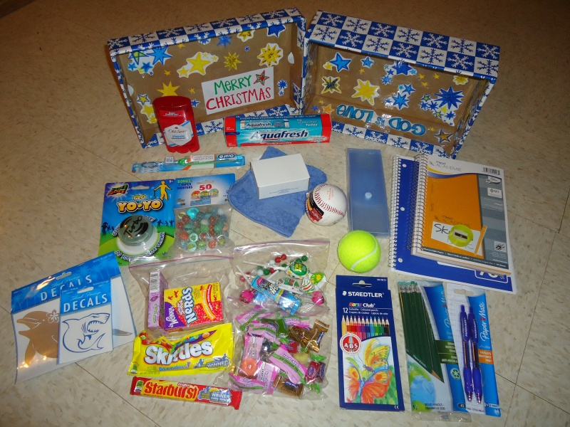 older boy box supplies - baseball, school supplies, marbles, a yo-yo, candy! etc.