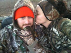 My husband + me, smooching from a deer stand.